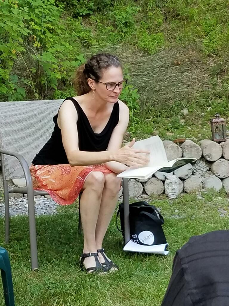 Jessica Cuello reads from Hunt at an outdoor event.